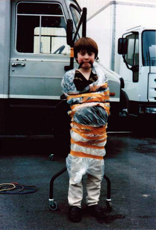 most amazing movie and TV behind-the-scenes of all time Daniel Radcliffe tied up on the set of David Copperfield after spraying various crew members with a water pistol