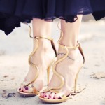 You won't believe how much these gold snake heels cost.