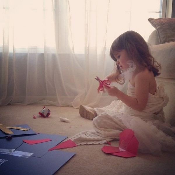 Mayhem creating her paper dresses.