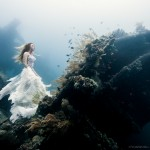 Surreal pictures of underwater nymphs on a shipwreck